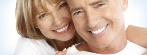 couple with dentures smiling