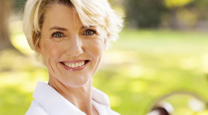 older-woman-smiling-702×390